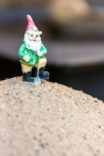 Close-up of small toy on retaining wall