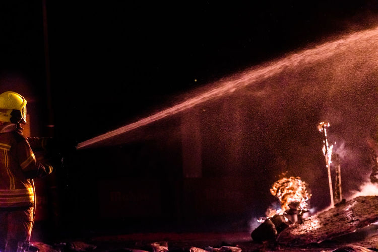 Blurred motion of illuminated fire at night