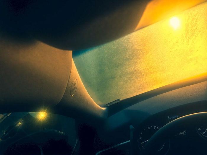 Tilt image of car against sky during sunset