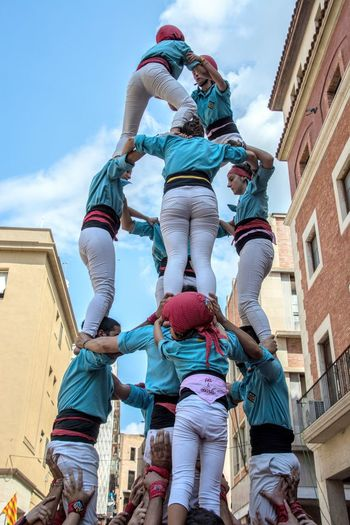 Human towers (castellers) Be Brave HumanTowers Tortosa Adult Castellers Castellers De Vilaseca Child Cloud - Sky Day Group Of People Leisure Activity Lifestyles Low Angle View Men Outdoors People Pit I Ovaris Real People Rear View Sky Togetherness Women