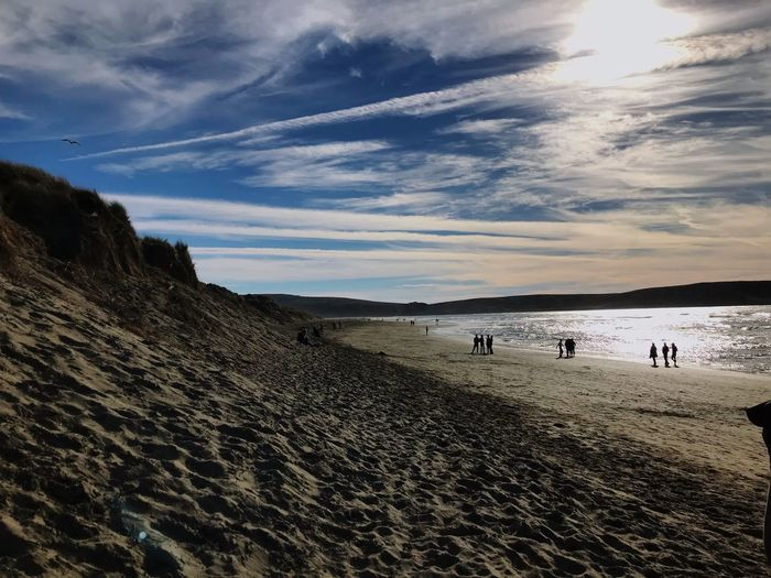 Dillan Beach Dillan Beach Sky Real People Beach Nature Beauty In Nature Men Sand Leisure Activity Large Group Of People Outdoors Women Lifestyles Scenics Cloud - Sky Adult People Landscape Day Mammal