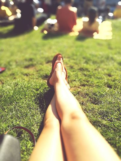 Low section of woman relaxing on grass