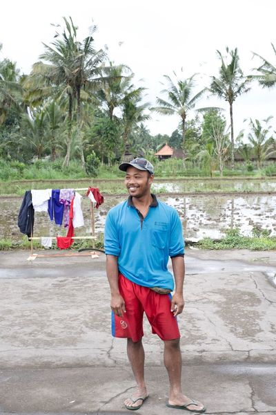 portrait of a Balinese rice farmer from my work documenting the living conditions of the Bali Mount Agung evacuees December 2017. Bali Copy Space Mount Agung Working Man Adults Only Balinese Blue Shirt Cap Casual Clothing Day Front View Full Length Lifestyles Nature One Man Only One Person Outdoors Palm Tree Portrait Real People Red Shorts Rice Farmer Sky Standing Young Adult