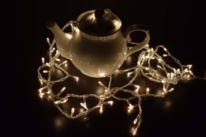 New Year Still Life Photography StillLifePhotography Black Background Christmas Christmas Decoration Close-up Glowing In The Dark Glowing Lights Illuminated Indoors  Night No People Still Life Still Life Photograpy Tea Pot Teapot Twinkle Light Twinkling Lights