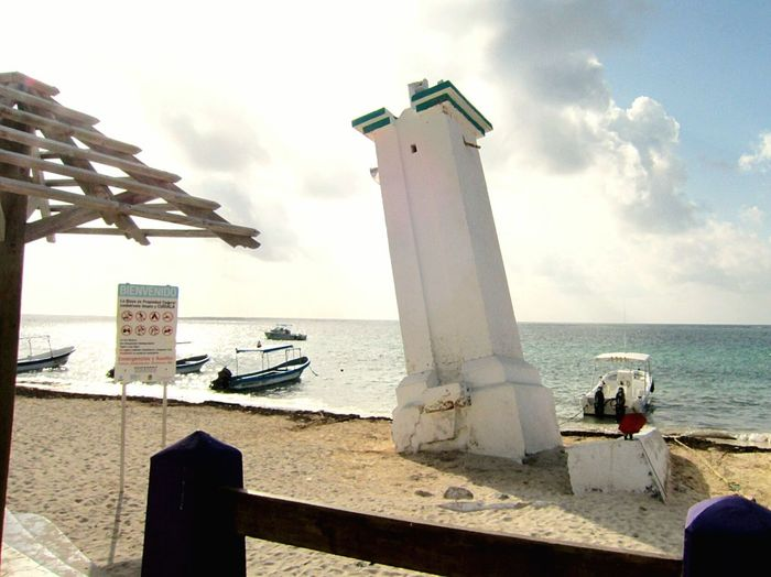 Public beach and old lighthouse tower in Puerto Morelos, Quintana Roo, Mexico Lighthouse No People Outdoors Water Nature Day Harbour Tower Pisa Tower Quintana Roo Mayan Riviera Riviera Maya Carribean Sea Tropical Beach Carribean Beach Fence Seascape Sky
