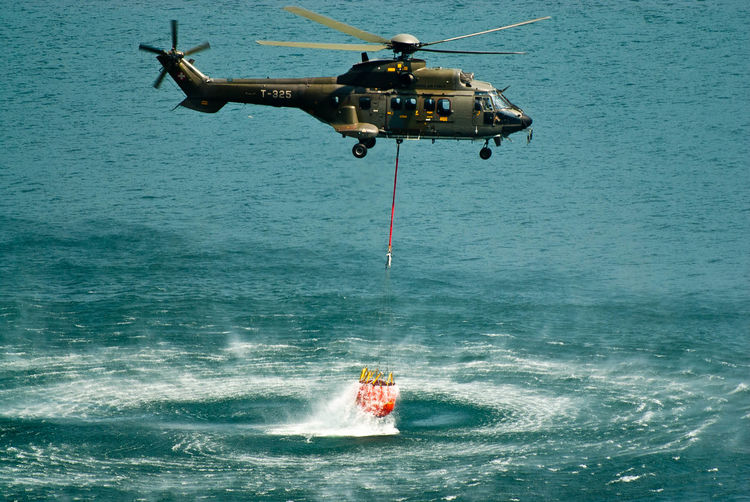 Helicopter Beauty In Nature Day Fire Department In Action Flying Military Military Training Mode Of Transportation Motion Nature Nautical Vessel No People on the move Outdoors Sea Speed Transportation Water Waterfront Wave