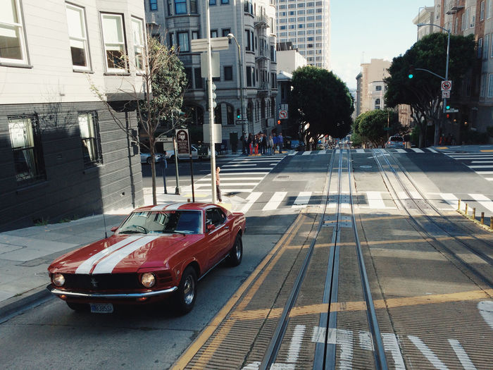 Architecture Building Building Exterior Built Structure Car City City Life City Street Ford Incidental People Land Vehicle Leading Mode Of Transport Mustang Road Sanfransisco Speed Street The Way Forward Traffic Transportation Urban