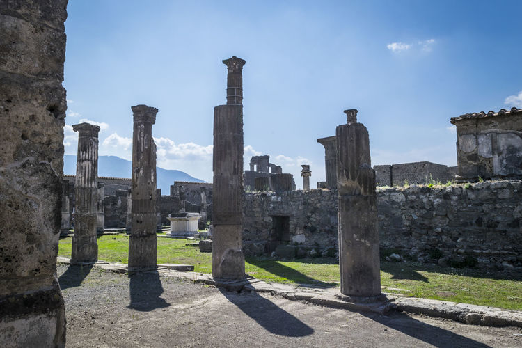 Ruins in Pompei, Italy. Detail of the archaeological excavations of Pompei, Italy. Pompeii  The Graphic City Travel Ancient Ancient Civilization Archaeological Archaeology Architectural Column Architecture Building Exterior Built Structure Day Detail Europe Excavations History Italy Monument Old Ruin Outdoors Sky Stone Material Sunlight The Past Travel Destinations