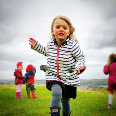 Amélie is enjoying kite flying so much she rugby tackles me to the ground with a big love hug. Little_munchkin_patch_Childcare