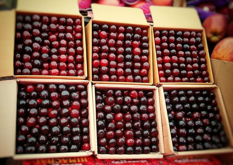 Close-up of fruits in crate at market stall