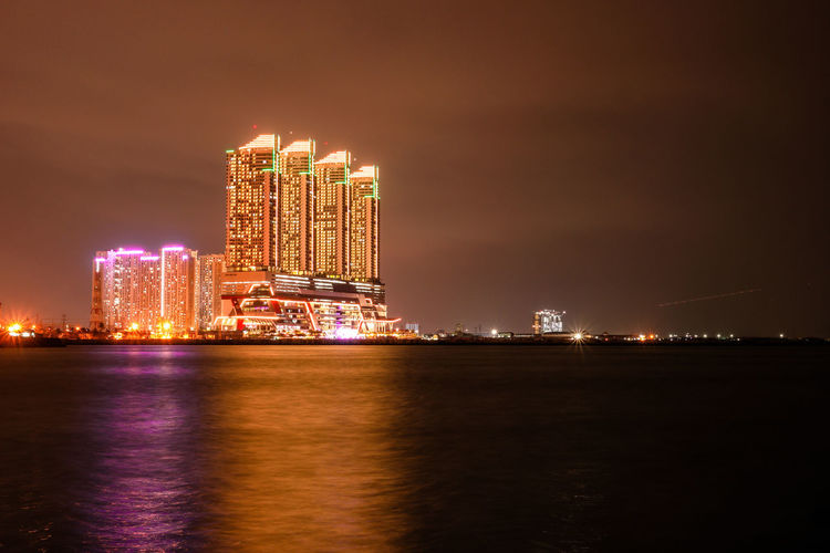 Architecture Building Exterior Built Structure Celebration City Cityscape Glowing Illuminated Lightning Long Exposure Luminosity Night Nightlife No People Outdoors Sea Sky Skyscraper Travel Destinations Urban Skyline Water Waterfront Colour Your Horizn