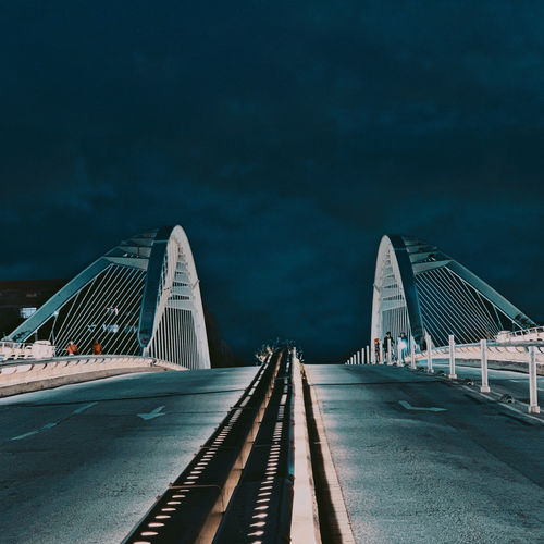 View of bridge against cloudy sky