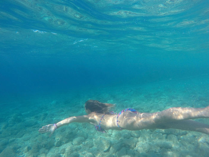 High Angle View Of Young Woman Swimming In Adriatic Sea