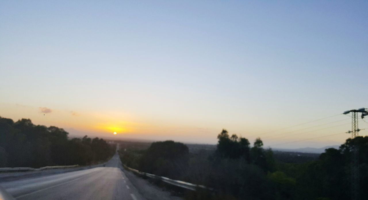 sunset, road, transportation, nature, scenics, the way forward, silhouette, tree, no people, sky, tranquil scene, sun, beauty in nature, landscape, outdoors, tranquility, clear sky, day