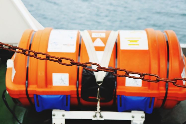 EyeEm Selects Orange Color Nautical Vessel No People Communication Text Rope Mode Of Transportation Close-up Hanging Safety Day Protection Transportation Life Belt Security Outdoors Focus On Foreground Sign