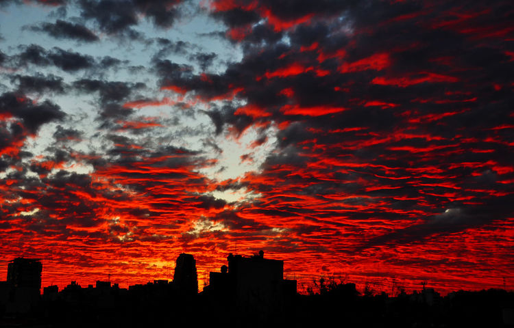 Fiery Sky in Buenos Aires, Argentina. Beauty In Nature Buenos Aires, Argentina  Cityscape Cloud - Sky Clouds And Sky Cloudy Dramatic Sky Majestic Moody Sky No People Orange Color Outdoors Overcast Red Sky Silhouettes Sky Skyline Sunset Sunset_collection Weather