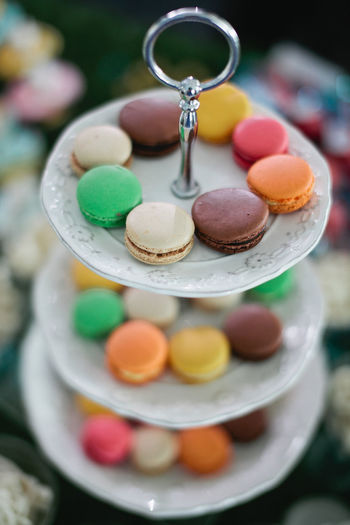 High angle view of fresh colorful macaroons on stand