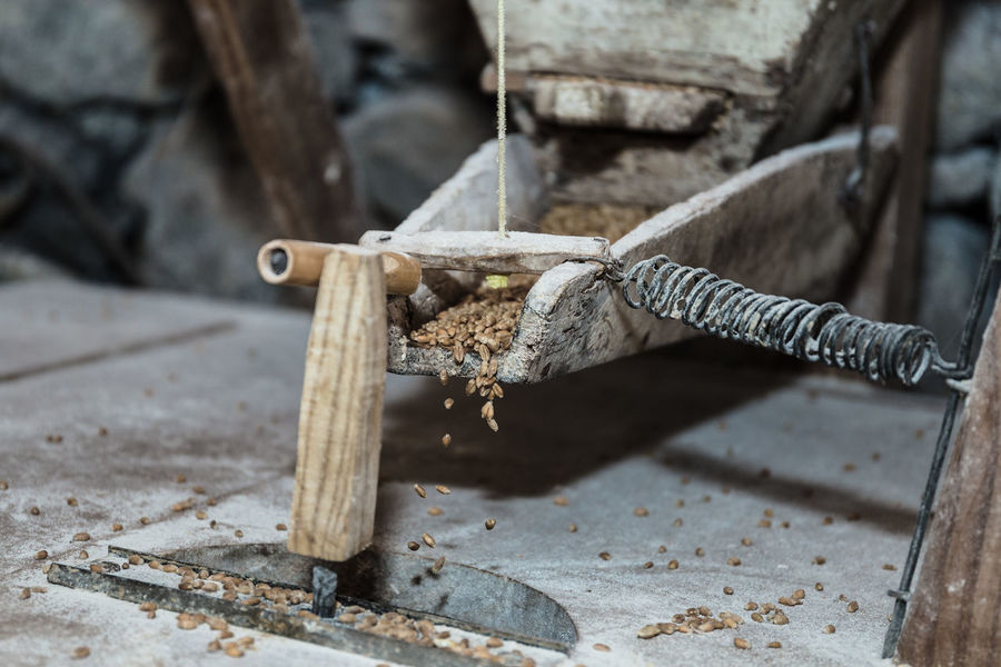 An old water mill grinding the corn grain. Madeira Island Mill Wheel Wheel Corn Grain Grind Grinding Grinding Wheel Indoors  Mill No People Old Old Buildings Photography Still Life Vintage Water Water Mill