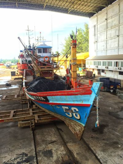 Shipyard Shipyard Nautical Vessel Transportation Mode Of Transportation Water Architecture Building Exterior Built Structure Moored Day Nature No People Fishing Industry Sky Outdoors City Port Harbor Street Fishing Boat Sea