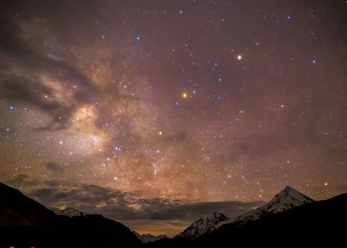 Astronomy Beauty In Nature Cloud - Sky Environment Galaxy Idyllic Majestic Milky Way Mountain Mountain Peak Mountain Range Nature Night No People Outdoors Scenics - Nature Sky Space Star Star - Space Tranquil Scene Tranquility