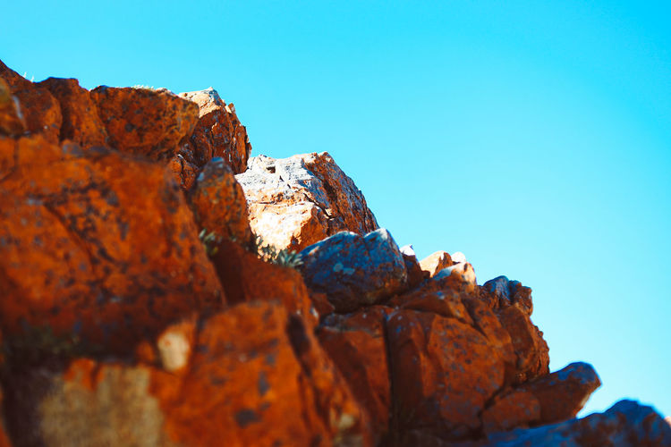 Rocks EyeEm Best Shots Nature Red Rock Shadow And Light Beauty In Nature Blue Clear Sky Contrast Copy Space Day Golden Ratio High Contrast Minimalism Nature Nature_collection No People Outdoors Rock Rock - Object Rock Formation Sky Solid Stone Sunlight Tranquility