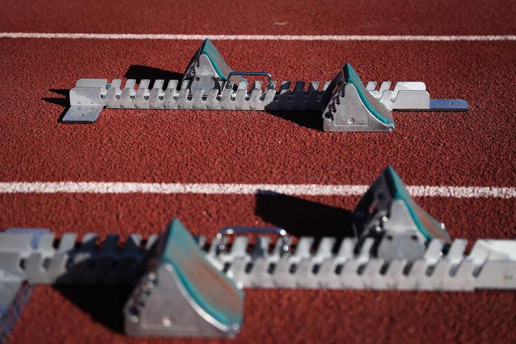 Tilt-Shift Image Of Equipment On Running Tracks