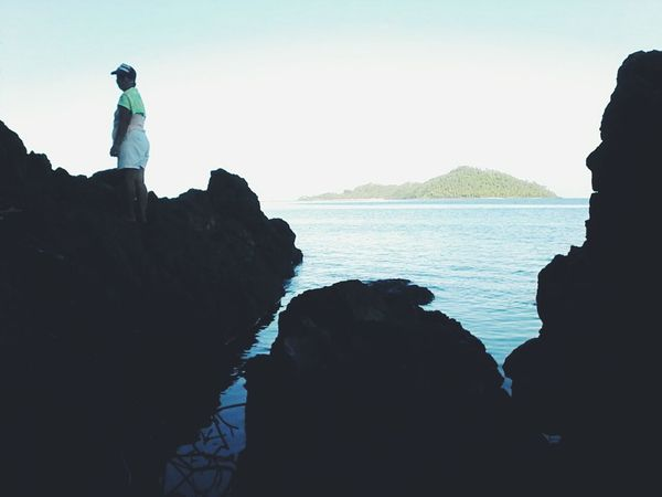 Silhouette Sea Rock - Object Outdoors People Adult Full Length Day Beach Sky Clear Sky Adults Only Nature Horizon Over Water One Person Earth Day 2k17 EyeEm Nature Lover