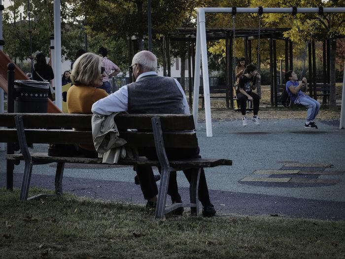 People sitting on walkway in park