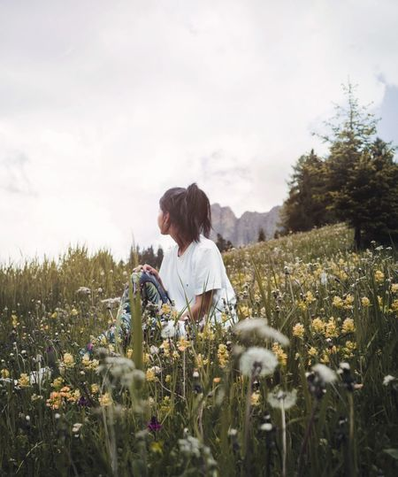 I will not run in circles, ending where i start - EDEN Plant Sky Field Growth Real People Flower Land Beauty In Nature Flowering Plant Lifestyles Nature Women One Person Landscape Young Women The Great Outdoors - 2018 EyeEm Awards The Traveler - 2018 EyeEm Awards