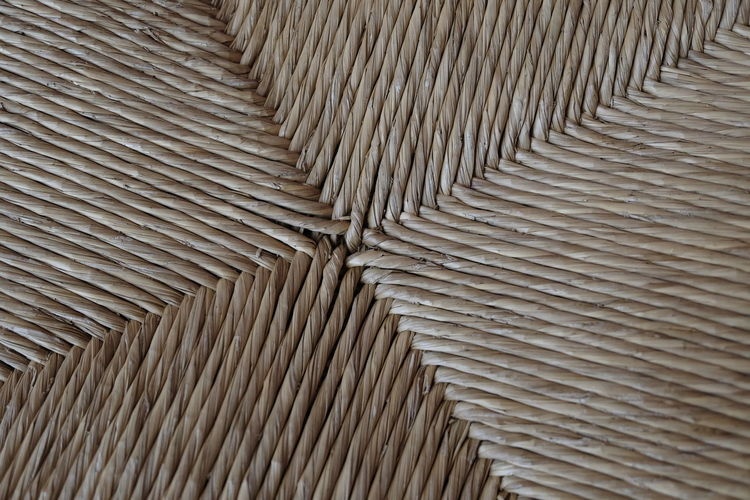 macro detail of a straw chair Textured  Straw Chair Handmade Background Rattan Rattan Chair Up Full Frame Pattern Close-up Abstract Brown