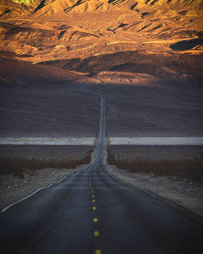 Driving through the Desert near the border of California and Nevada. Road Transportation Direction Road Marking The Way Forward Nature Beauty In Nature Scenics - Nature No People Diminishing Perspective Non-urban Scene Tranquility Tranquil Scene Water Land Marking Environment Landscape Day Outdoors Desert