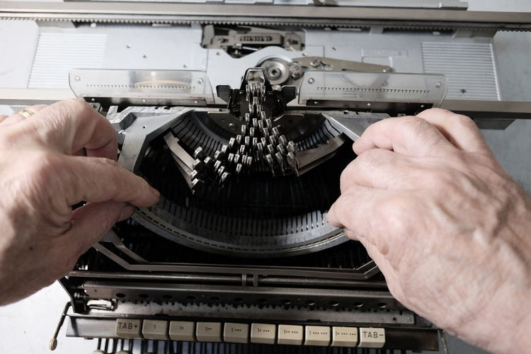 technician repairs old typewriter Antique Hands Obsolete Service Equipment Hand Human Hand Manual Worker Mechanic Men Occupation Old Repairing Technician Technology Typewriter Unrecognizable Person