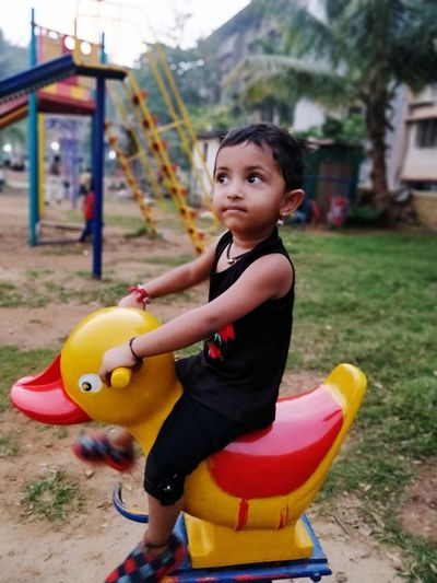 Spring Ride Outdoor Play Equipment EyeEm Selects Child Childhood One Person People Girls Cute One Girl Only Children Only Full Length Playing Lifestyles Fun Portrait Built Structure Beauty Happiness Sitting Smiling Outdoors