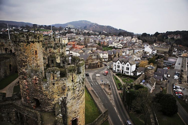 High Angle View Of Conwy Castle And Buildings In Town
