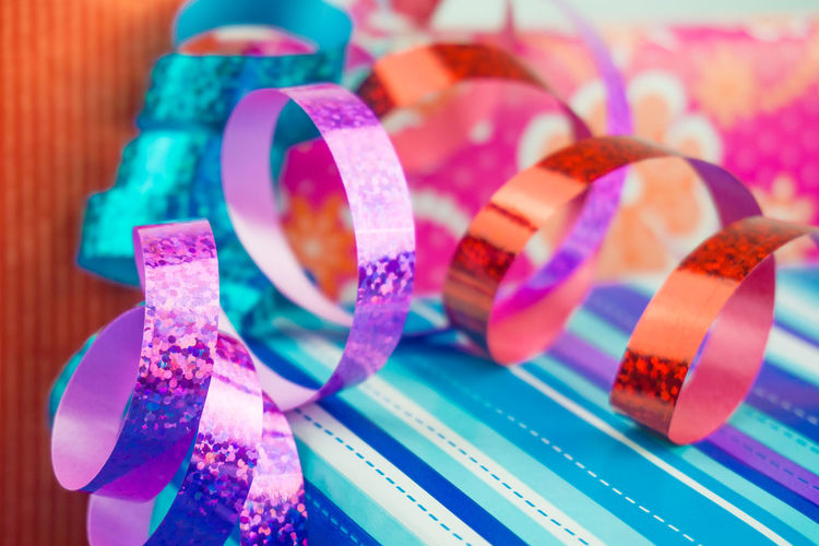 Close-up of shiny ribbons on table