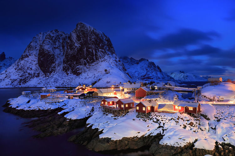 Illuminated fishing village at lofoten island during winter