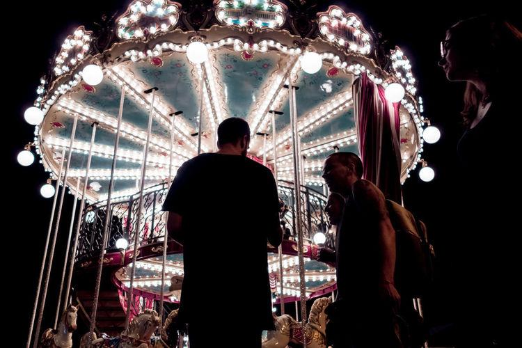 Rear view of people enjoying at amusement park