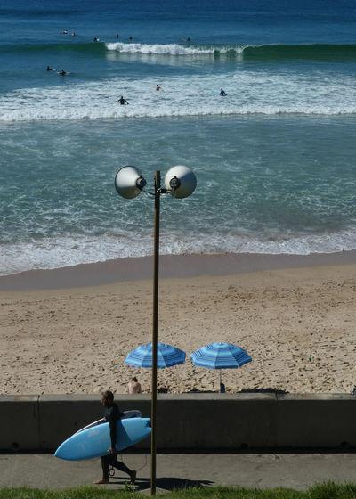 Deck chairs on beach against sea