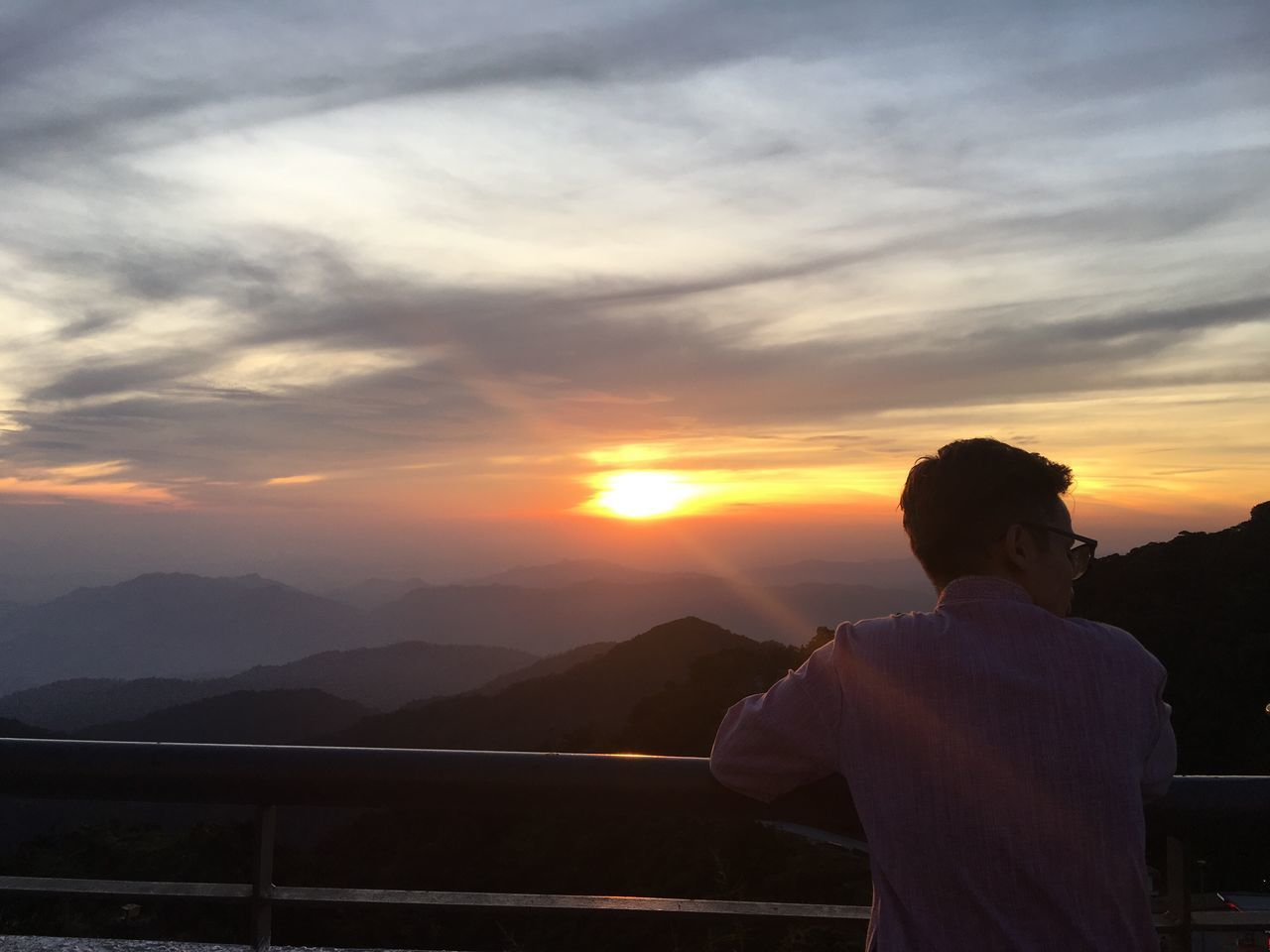 sunset, real people, sky, one person, scenics, nature, mountain, standing, rear view, lifestyles, leisure activity, sun, beauty in nature, looking at view, outdoors, cloud - sky, silhouette, men, day, people