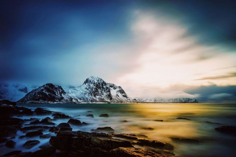 NORWAY - JANUARY 17: Water sea blue and orange sky light Mountains Alps Watersea Dark Cloudly Sky Travel Snowy Norway Deep Tourism Environment Landscape Galaxy Mountain Pixelated Technology Water Sunset Sea Milky Way Adventure Exploration Glacier Iceberg Glacial Global Warming Lagoon Ice Mountain Peak