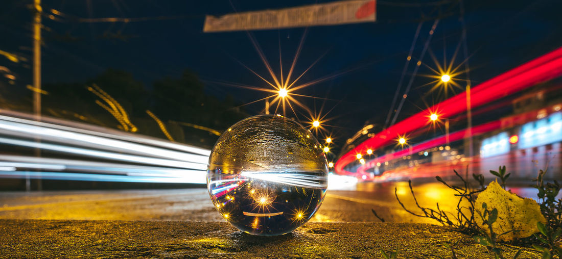 Through a glass ball City Glass Ball Traffic Architecture Building Exterior Built Structure Close-up Illuminated Long Exposure Nature Night No People Outdoors Reflection Traffic Lights