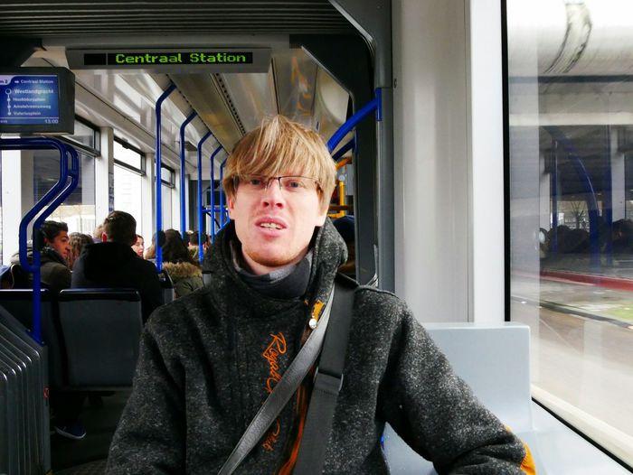 Portrait of man traveling in metro train