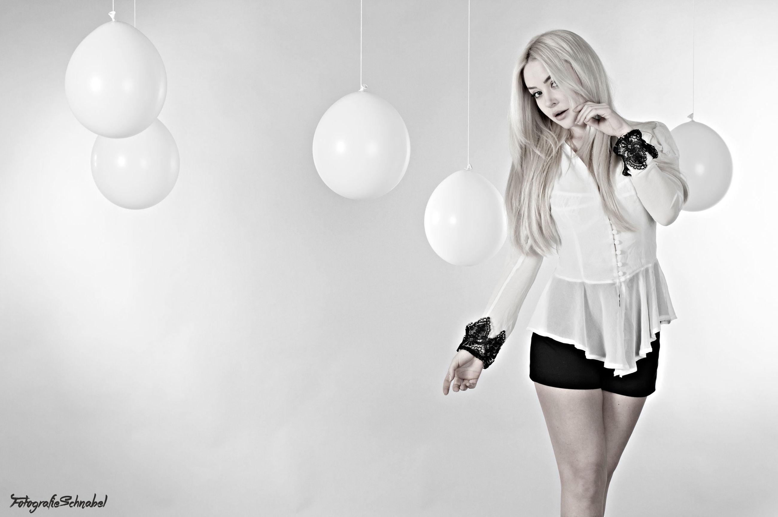 indoors, standing, casual clothing, holding, enjoyment, studio shot, young adult, arrangement