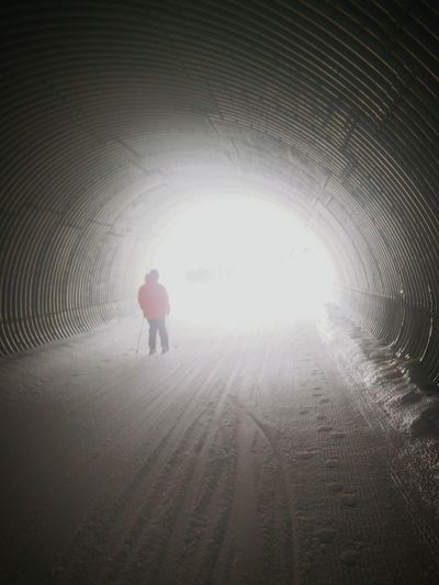 Full length of woman in tunnel