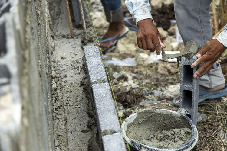 Low section of man working on concrete