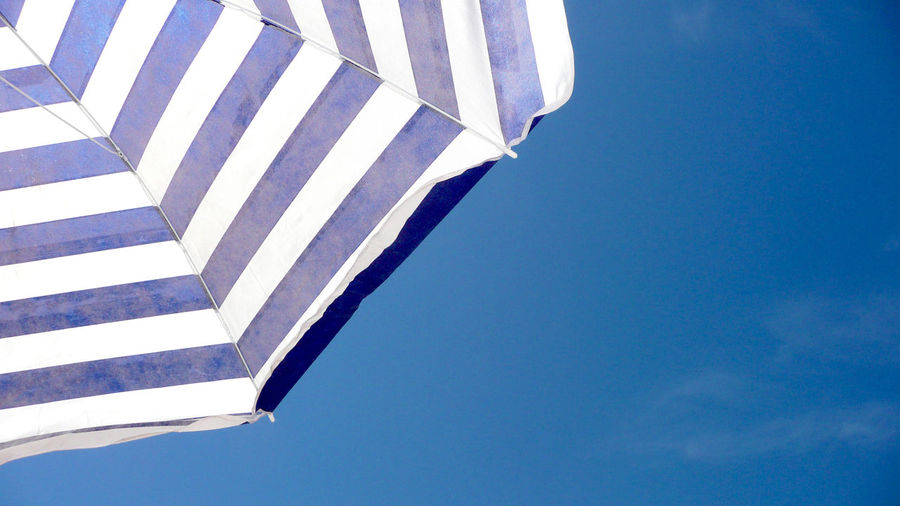 a parasol at the sea Backgrounds Blue Holiday Low Angle View Meer No People Outdoors Parasol Pattern Plage Sea Sky Sommer Sonne Sonnenschein  Sonnenschirm Strand Stripes Everywhere Summer