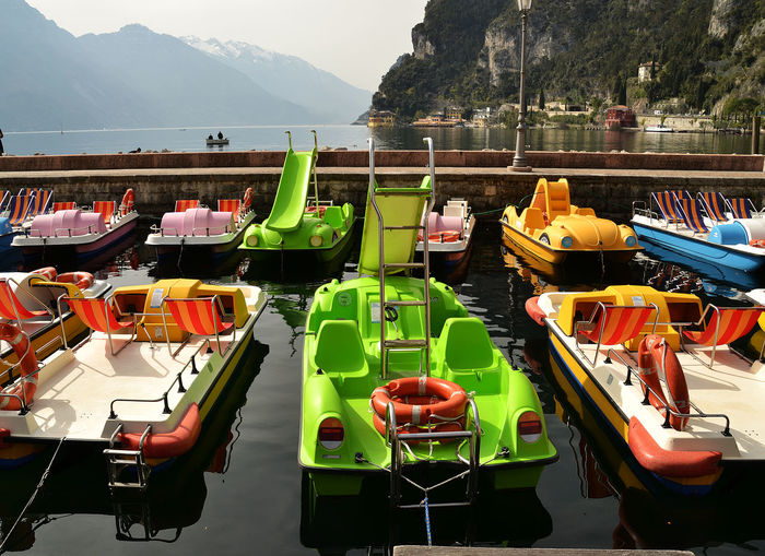 Pedal boats at harbor in lake garda
