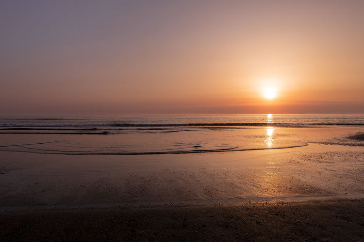 Sunset over North Sea in Denmark with beach Beach Beauty In Nature Environment Horizon Horizon Over Water Idyllic Land Nature No People Outdoors Reflection Scenics - Nature Sea Sky Sun Sunlight Sunset Tranquil Scene Tranquility Water