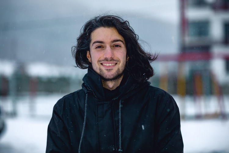 Portrait of smiling young man during winter