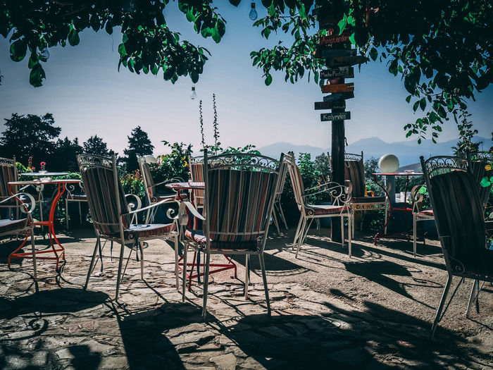 Absence Architecture Cafe Chair Clear Sky Day Empty Growth Land Nature No People Outdoors Plant Relaxation Seat Setting Shadow Sky Sunlight Table Tree